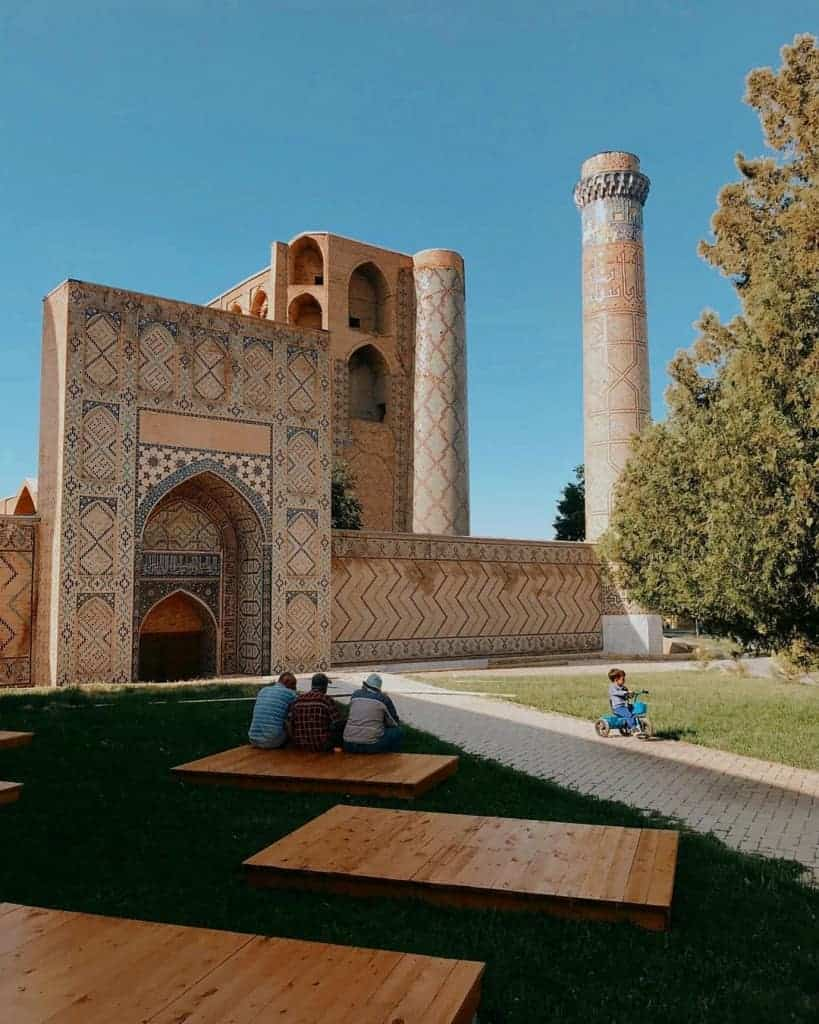 Local men sit outside the Bibi Khanym Mosque in Samarkand