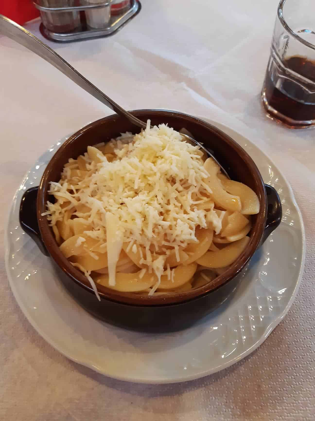 Sampling the local food: homemade pasta with smoked metsovone cheese