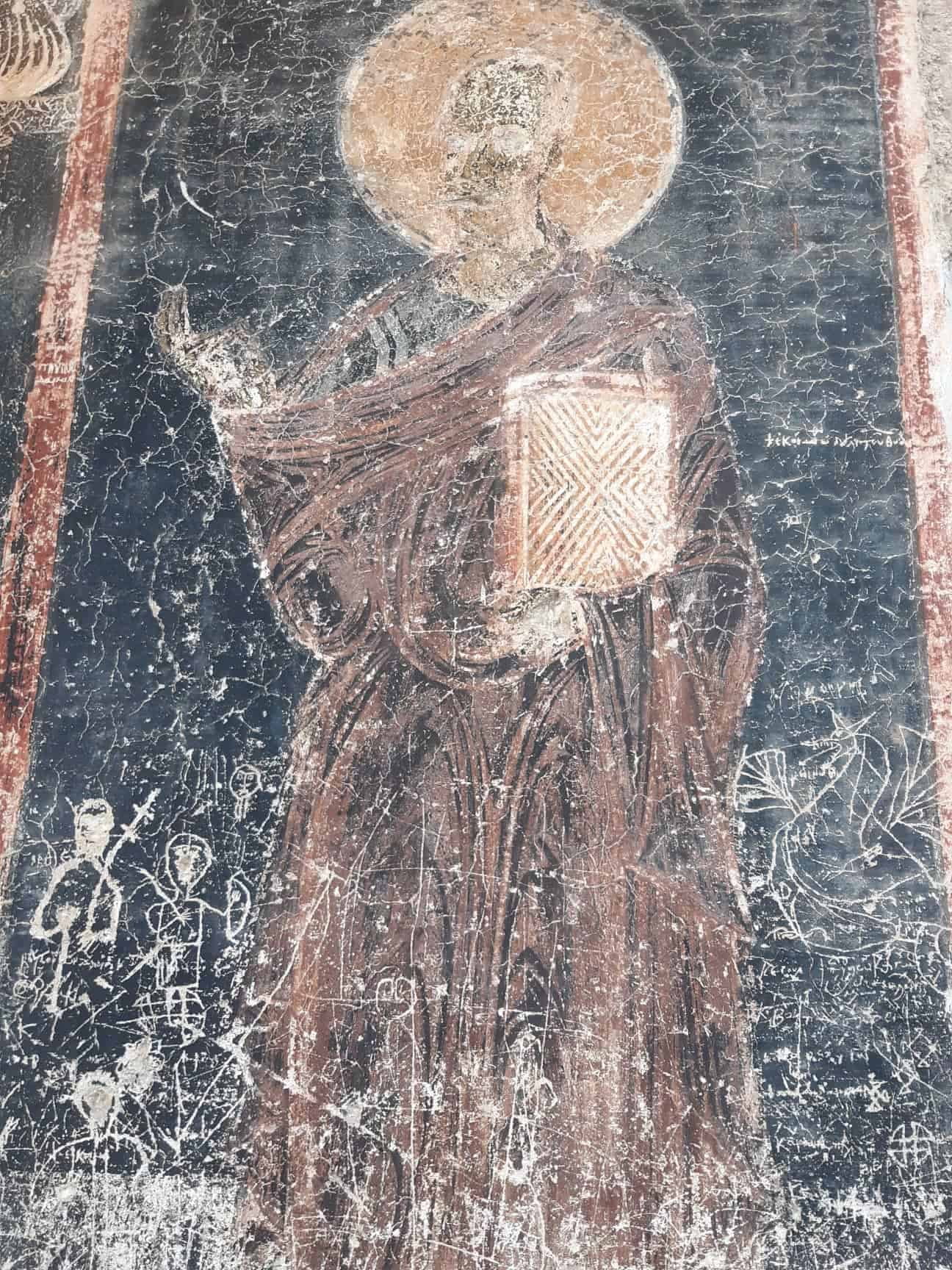 Worn Byzantine frescoes in ancient churches. The eyes were scratched out during the Ottoman occupation.